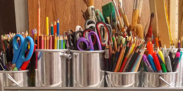 colored pencis and paintbrushes