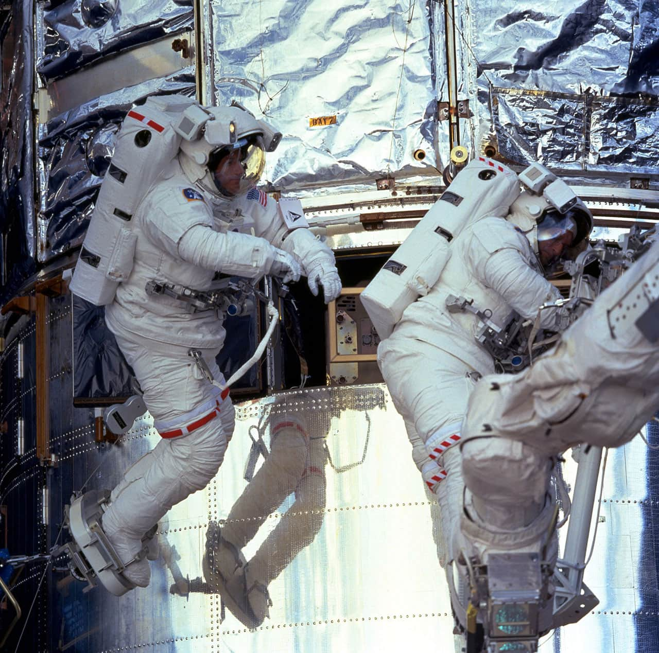 Astronaughts working on Hubble